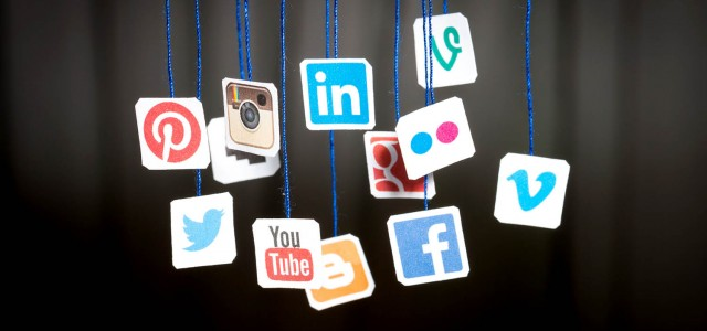 Bełchatów, Poland - August 31, 2014: Popular social media website logos printed on paper and hanging on strings.